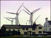 Group of UK wind turbines near houses   BBC