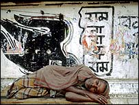 Man sleeping on ground in India