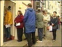 People queuing to register for NHS treatment