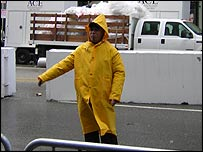 Security guard watches red carpet area during rain