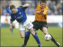 Leicester striker Paul Dickov is challenged by Wolves defender Lee Naylor