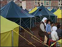 Family among sea of tents in al-Hoceima