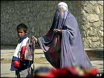 Woman in burqa begs with child   AP