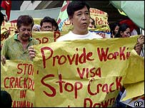 Filipino migrant workers rally in Manila over a crackdown on undocumented migrant workers in Taiwan and South Korea