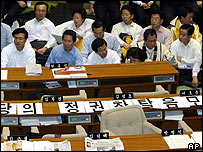 Uri Party lawmakers stage a sit-in in the South Korean parliament