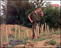 A British Army officer at the scene of a mass grave, in the village of Kacanik, Kosovo, June 1999