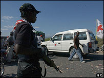Rebel on guard as Red Cross van arrives in Gonaives