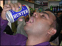 Mohammed Iqbal Hussain drinking Hunter malt drink