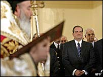 Archbishop Christodoulou (left) swears in the government