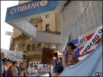 Demonstrators protest outside a Citibank branch in Buenos Aires