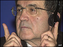 European Commission President Romano Prodi listens to translation