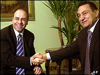 Shalom (left) and Mubarak shake hands during meeting