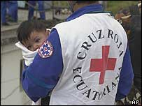 Baby Heidi Carolina being held by a  Red Cross paramedic