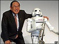 Toyota's president with the trumpet-playing robot