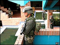 Colombian soldiers at seized property