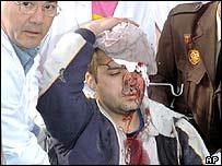 Doctor treats injured victim