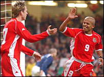 Wales scorers Gareth Taylor and Rob Earnshaw celebrate
