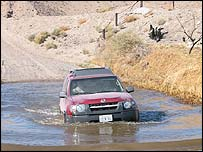 Truck in desert river, Darpa