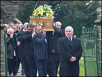 Pall bearers and family at Mrs Evans' funeral