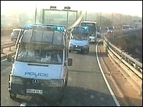 Police vans escorting the buses: photo courtesy of Amnesty