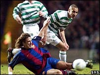 Carles Puyol keeps the ball away from Henrik Larsson