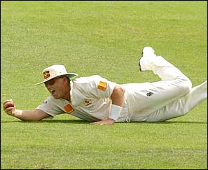 Warne acrobatically dives to dismiss New Zealand's Nathan Astle in a Test in 2000