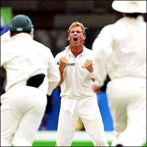 Australian players surge towards Warne after becoming the first spinner to claim 500 Test wickets in his first Test since being banned for a year