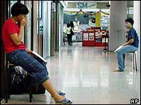 Girls waiting outside a Maids agency in a  shopping mall in Singapore
