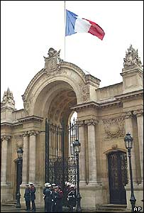 The flag hangs at half-mast at an entrance to the Elysees Palace on Friday