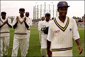 Muttiah Muralitharan is applauded off the field after a dazzling display against England in 1998