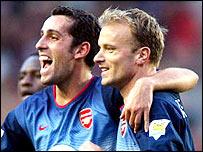 Arsenal team-mate Edu (left) and Dennis Bergkamp