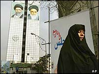 Portraits of Iran's supreme leader Ayatollah Ali Khamenei (left) and the late revolutionary founder Ayatollah Khomeini gaze down onto central Tehran