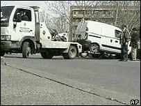 A recovery team removes a van where seven detonators and a tape recording of Koranic verses