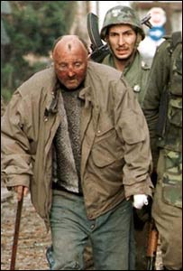 Serb troops lead Croat civilian after entry into Vukovar in 1991