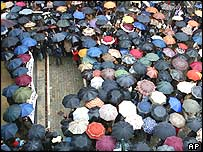 People gather to protest Thursday's attacks in a square in Pamplona on Friday