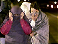 A group of illegal immigrants hide their faces as they try to enter the UK