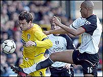 Mark Viduka of Leeds is challenged by Zat Knight of Fulham