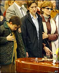 The wife and son of Felix Gonzalez at his funeral