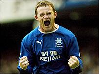 Wayne Rooney celebrates netting the winner for Everton