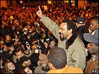 French comic Dieudonne addresses a crowd outside the Olympia theatre