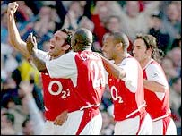 Edu leads the goal celebrations for Arsenal