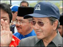 Former Prime Minister Mahathir Mohamad waves to his state's candidates at the nomination centre in Kedah