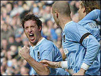 Robbie Fowler celebrates Man City's opening goal