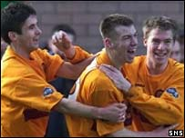 Paul Quinn (centre) celebrates against Kilmarnock