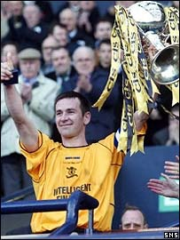 Stuart Lovell holds aloft the CIS Cup