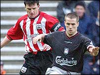 Michael Owen failed to convert the dubious penalty conceded by Jason Dodd (left) for a foul on Harry Kewell