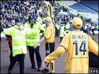 Stewards prevent Stuart Lovell approaching fans