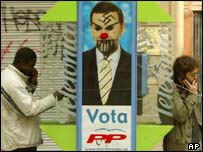 Election poster with a swastika drawn on the face of ruling Popular Party candidate Mariano Rajoy in Barcelona