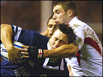 England's Ben Cohen halts a charge from Scotland wing Simon Danielli