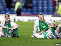 Hibs players take in the despair of defeat
